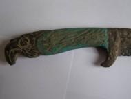 Скифский ятаганоподобный боевой нож с рукояткой в виде головы орла