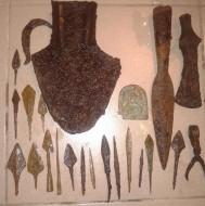 бронзовая иконка-оберег, топор-чекан. наконечник копья, наральник, и другие изделия из железа