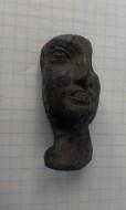 Бронзовое лицо, вероятно от статуи. Древний Рим