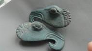 Скифские бронзовые бляхи в виде голов грифонов