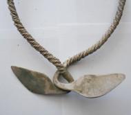 Орнаментированное  утолщенные концы шейной гривны, с рунами и свастикой