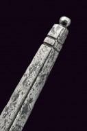 кончик крестовины рыцарского меча