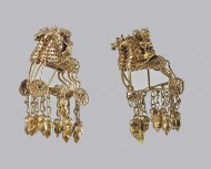 Сарматские серьги с изображением коней на колёсах