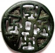 Фибула с вырезами в виде свастик и  с остатками эмали в выемках. Черняховская или Киевская культура