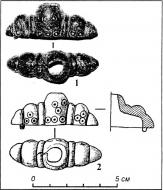 Деталь бронзового навершия рукояти средневекового меча, которая была обнаружена на Черновском городище первой половины XIII в.