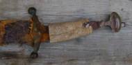 Сабля с остатками рогового покрытия рукояти и серебряной бутеролью