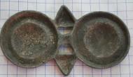 Средневековая бронзовая накладка с изображением баранов