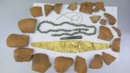 Клад Трипольской культуры с золотым украшением