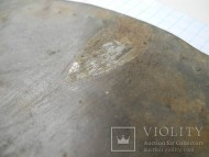 Раннескифское бронзовое зеркало с узорами, инкрустацией серебром