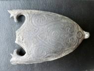 Древнерусский наконечник ножен меча с инкрустированным чернью растительным орнаментом