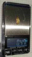 Золотой амулет с изображением человечка