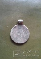 Древнерусская монетовидная подвеска с солярным амулетом