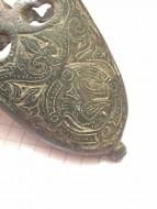 Древнерусский бронзовый наконечник ножен с растительным орнаментом