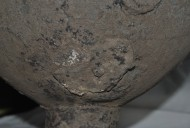 Заплата на днище древнего бронзового котла