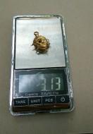 Золотая серьга с изображением Януса Двуликого