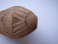 Каменная средневековая детская игрушка