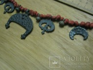 Полный набор нагрудных лунниц на бусах периода Киевской Руси