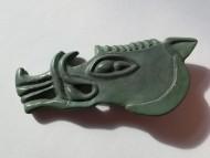 Большая скифская бляха в виде головы кабана