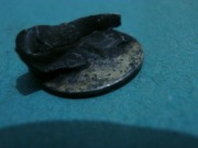 Серебряный монетовидный щиток от перстня со свастикой