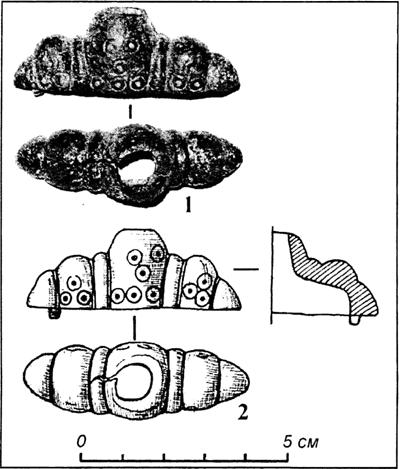 Головка навершя руків'я меча з Чорнівського городища (1 – фото, 2 – прорисовка).